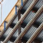 Wat houdt de hoofddraagconstructie van een gebouw in?
